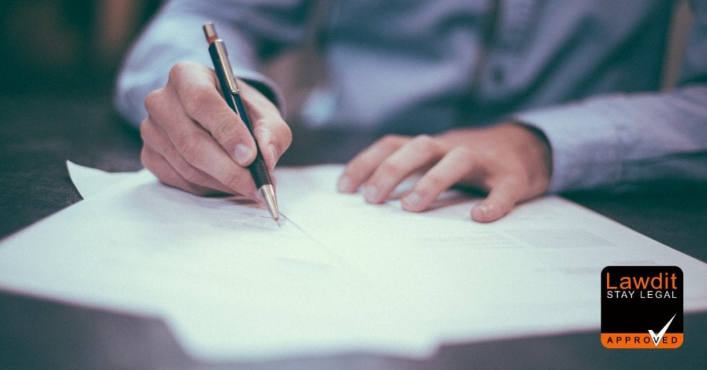 picture of a man writing a contract