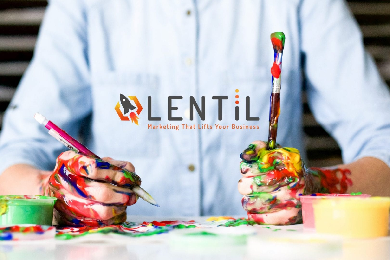 Man with pain brushes and Lentil Marketing logo