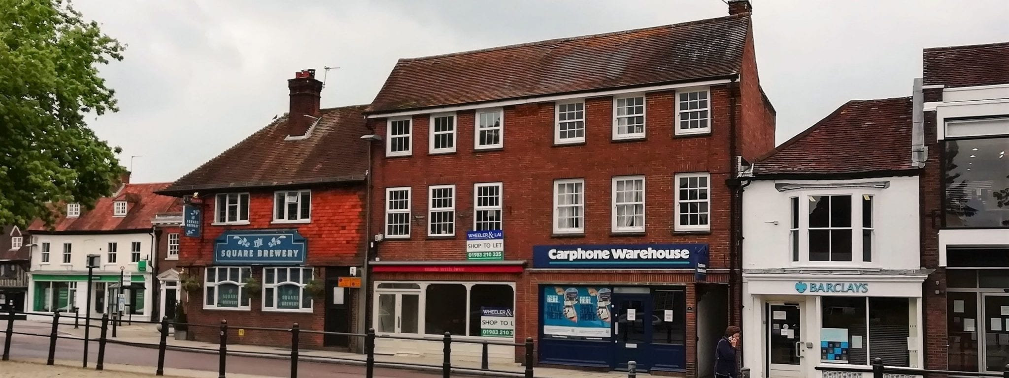 Commercial property - historic town centre retail parade with wheeler and lai chartered surveyors agency board to let