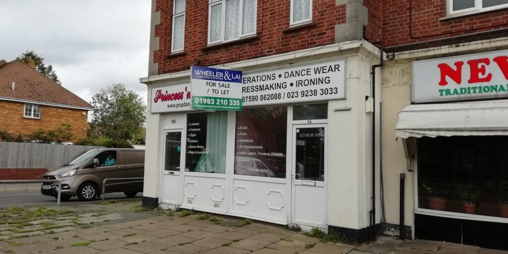 Commercial property agents wheeler and lai for sale board on shop
