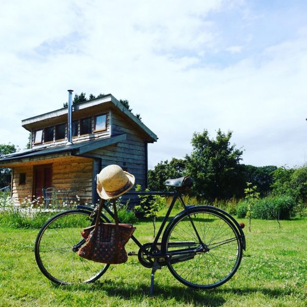 Tiny Homes Holidays - Eco-friendly lodges for off-grid vacations on the Isle of Wight, set in a natural meadow, adjacent to ancient woodland