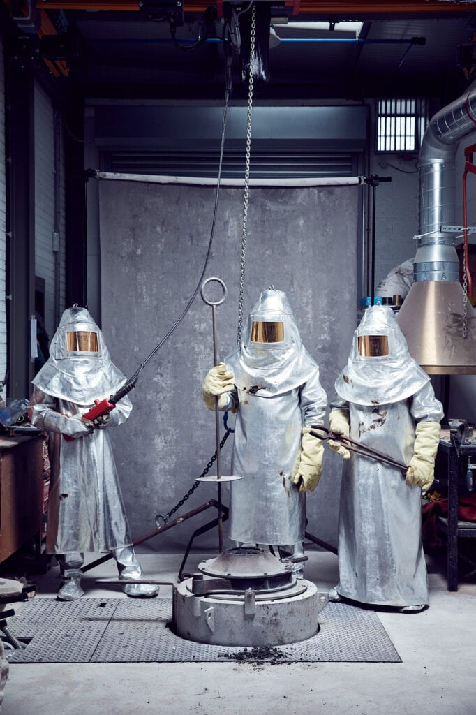 3 figures in protective suits