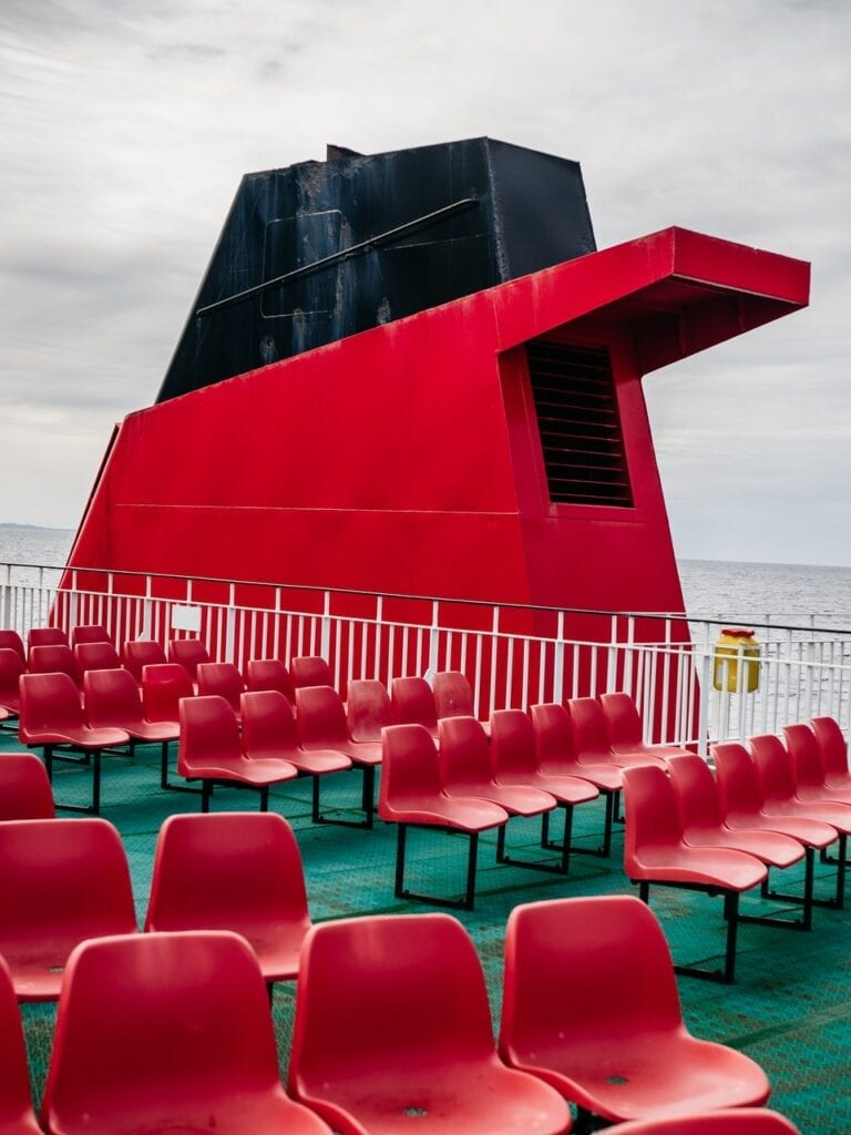 Chimney of a red ship with empty seats